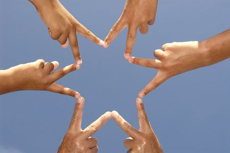 Fingers together forming a six point star Stock Photo - 4601756