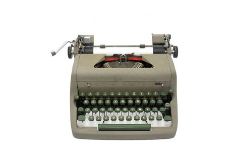 correspond: Very old typewriter isolated in white
