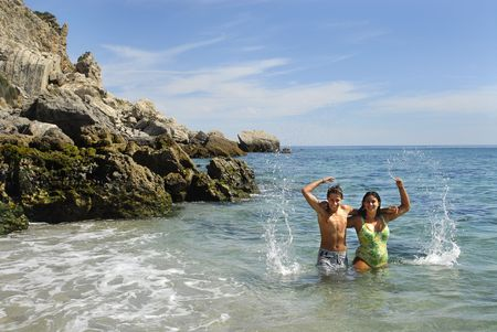 Young couple playing in the sea Stock Photo - 4738326