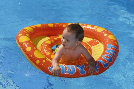 floater: Beautiful baby with floater in the pool
