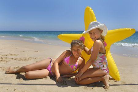 beach blond hair: Girls posing in the beach Stock Photo