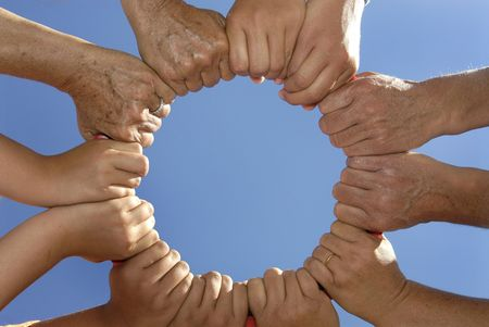Several hands holding together in a circle Stock Photo - 4842016