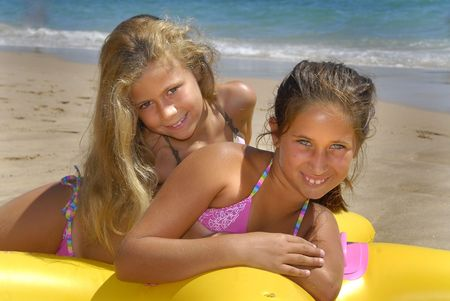 Two girls posing in the beach Stock Photo