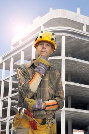 constrution site: Worker with constrution site in the background Stock Photo