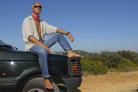 Mature man model posing in a 4x4 outdoors photo