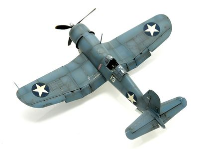 Model kit of an WWII american fighter isolated in white photo