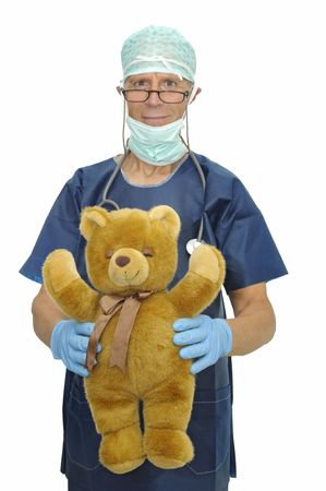 Doctor with teddybear isolated in white photo