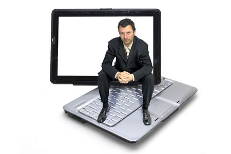 Businessman seated in a notebook isolated against a white background photo