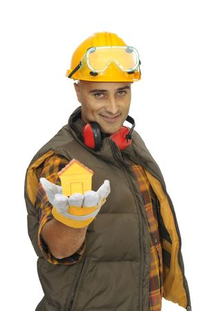Worker with hat showing a little house in is hand isolated in white photo