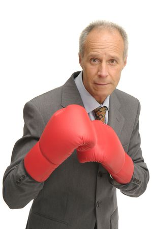 Businessman with boxing gloves isolated in white photo