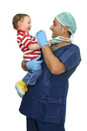 Doctor with baby and syringe having fun isolated in white photo