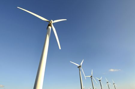 Wind turbines isolated against the sky photo