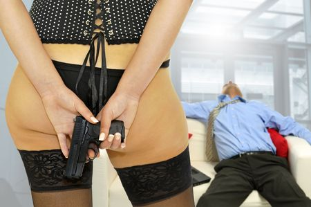Woman with  a gun behind her back and  a sleeping man in the background