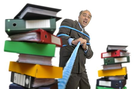 office slave: Desperate businessman with a rope pulling a stack of files  isolated in white