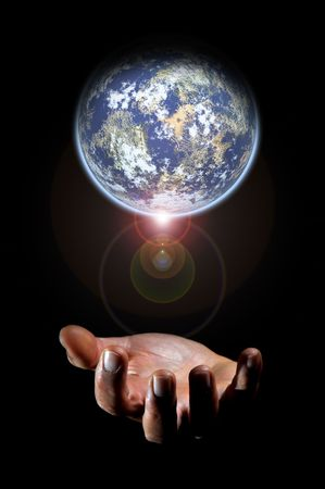 Human hand and planet earth isolated in a black background photo