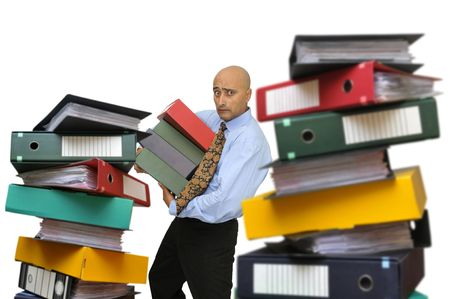 office slave: Tired businessman with heavy files isolated in white Stock Photo