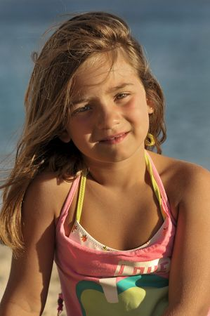 kids playing water: Young girl posing in the beach