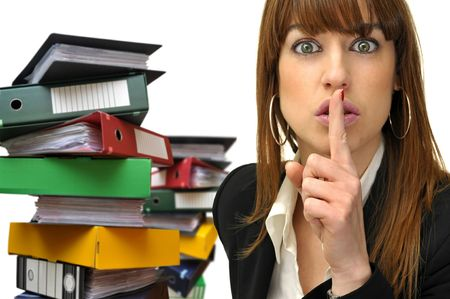 Businesswoman asking for silence and stacks of files in the background Stock Photo - 5705808