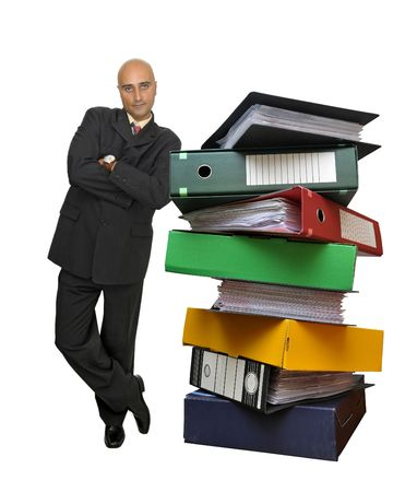 Businessman with a stack of files isolated in white Stock Photo - 5712621