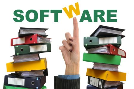 office chaos: Businesswoman hand pointing the word software with old files around Stock Photo