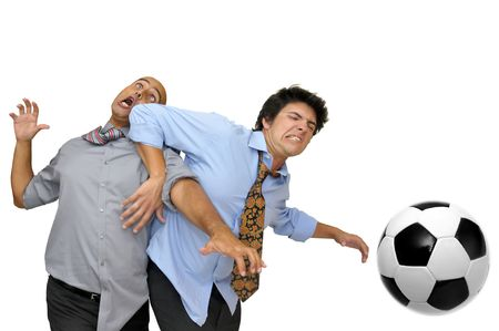 Two businessmen fighting for a soccer ball  isolated in white photo