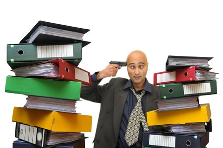 Desperate businessman with a gun and files everywhere isolated in white Stock Photo - 5731177