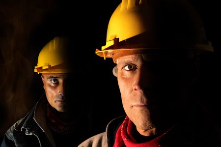 coal miner: Workers team  isolated in black Stock Photo