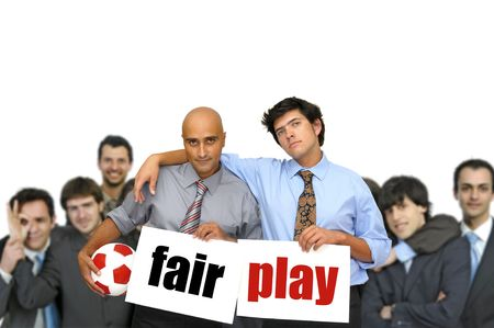 fairplay: Team of  businessmen with soccer ball and white cards with the words fair play isolated in white