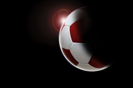 Soccer ball planet isolated in black photo