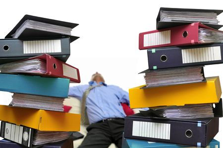 Tired businessman with stacks of files isolated in white Stock Photo - 5765633