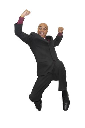 Happy businessman jumping against a white background photo