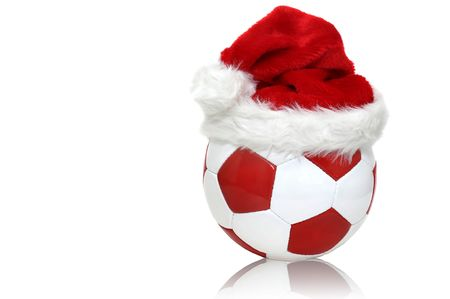 Soccer ball with a santas hat isolated in white photo