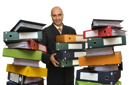 Businessman stacking files isolated in white Stock Photo - 5791981