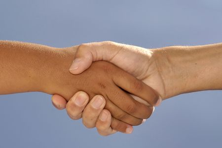 Handshake isolated against the blue sky Stock Photo - 5843301
