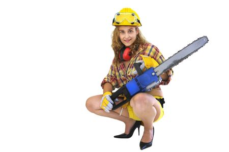 Young sexy girl worker with chainsaw isolated in white photo