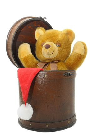 Old case with chrismas hat and teddybear isolated against a white background photo