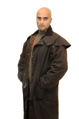 Man posing with a raincoat isolated against a white background Stock Photo - 5947336