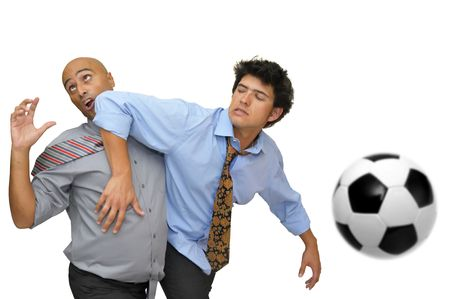 Two businessmen fighting in a soccer game  isolated in white photo