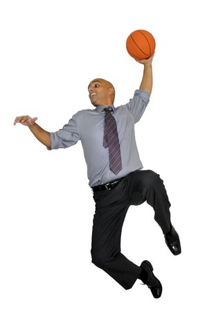business game: Businessman jumping with basketball for a dunk isolated in white