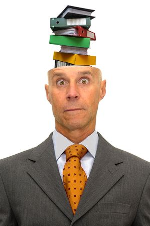 Mature businessman with stack of files coming out of his head Stock Photo - 5976652