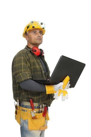 Construction worker with laptop isolated in white photo