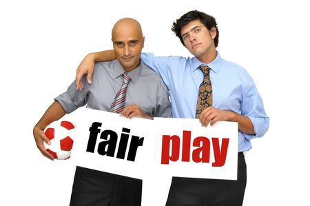 fairplay: Two businessmen with soccer ball and white cards with the words fair play isolated in white Stock Photo