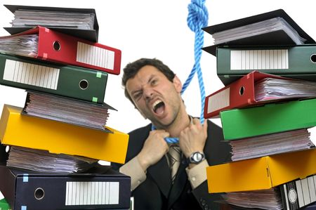 office slave: Desperate businessman hanging himself with files everywhere isolated in white