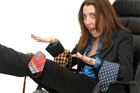 Businesswoman tied with ties isolated against a white background photo