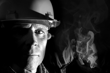 coal  mine: Portrait of a firemanr isolated in black Stock Photo