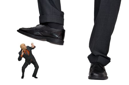 affraid: Mature businessman affraid of big CEO foot isolated in white