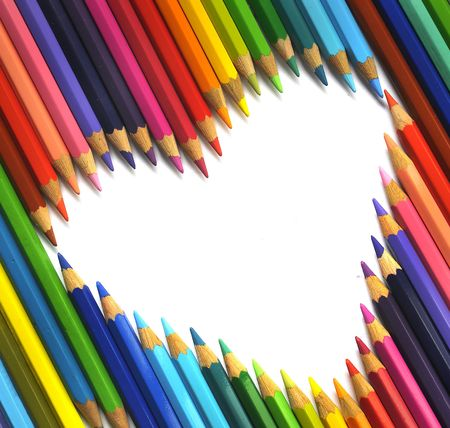 Color pencils background isolated in white photo