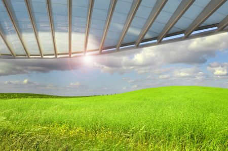 moderm: Beautiful wallpaper image of a grass field with  cloudy sky and a moderm roof structure