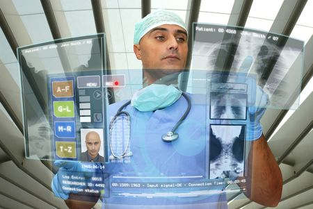 Doctor with hightech computer screen viewing patient data Stock Photo - 6503354