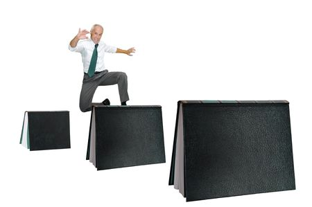 hurdling: Businessman jumping over books isolated in white